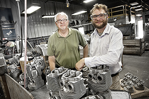 David Weiss (left) and Simon Beno oversee production of a metal composite at Eck Industries in Manitowoc, Wisconsin. The foundry will supply their startup, Intelligent Composites. (UWM Photo/Troye Fox)