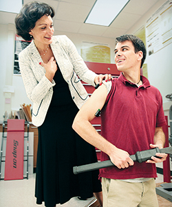 "Naira Campbell-Kyureghyan measures muscle activation on undergraduate Quinn Porter as he uses the ""ergo"" wrench. (UWM Photo/Troye Fox)"