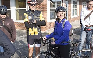 Chancellor Mark Mone joins a group May 20 for Bike to Work Day. UWM Photo/Troye Fox)
