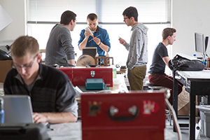 Students in Hanlon's studio class collaborate on a plan to revive a depressed area in Detroit while housing refugees. (UWM Photo/Troye Fox)