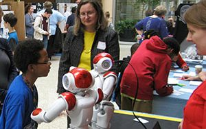 UWM'S Susan McRoy, center, and Vanessa Radlinger, right, demonstrated Nao robots at the 2016 MPS STEM Fair April 21 at the Milwaukee County Zoo.