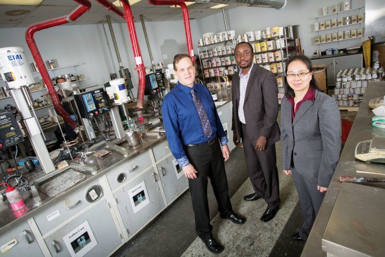 UWM mathematics Professor Bruce Wade (left), graduate student Emmanuel Asante-Asamani (center) and mathematics professor Lei Wang at Rust-Oleum's facility in Pleasant Prairie, Wisconsin.