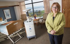 UWM Professor Christine Kovach and her team went to Milwaukee's Jewish Home and Care Center to see if a germ-busting robot lived up to its name. (UWM Photo/Troye Fox)