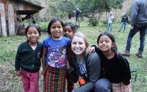 Cassandra Bence smiles with four young Guatemalan girls while working in Guatemala with Engineers Without Borders.