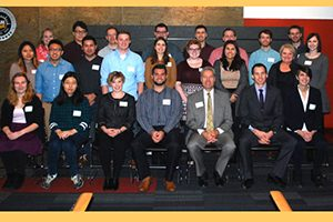 School of Information Studies students showed Chancellor Mark Mone their work in helping nonprofits improve their information technology.