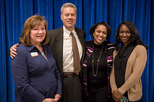 MATC President Vicki Martin, UWM Chancellor Mark Mone and MPS Superintendent Darienne Driver pose with new MPS teacher Saidah Sheppard, a proud alumna of all three institutions.