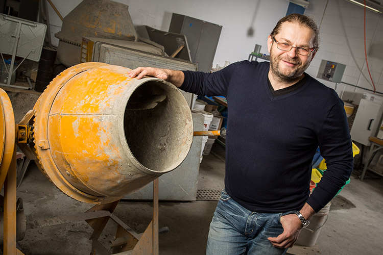 Konstantin Sobolev with a cement mixer.