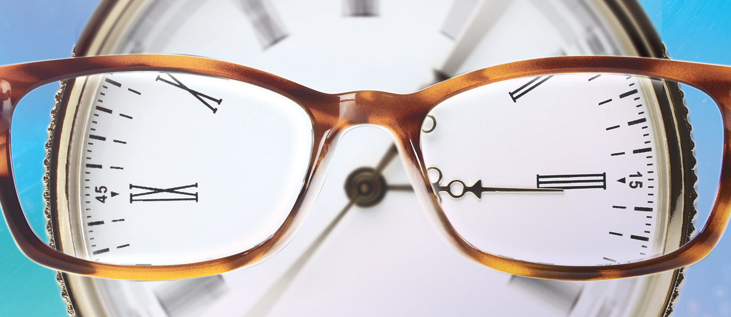 An image of glasses over a clock