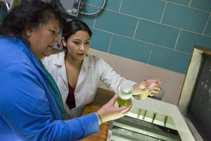 Cristal Sanchez-Estrada (right) works in lab with Carmen Aguilar, an associate scientist in the School of Freshwater Sciences. (UWM Photo/Troye Fox)