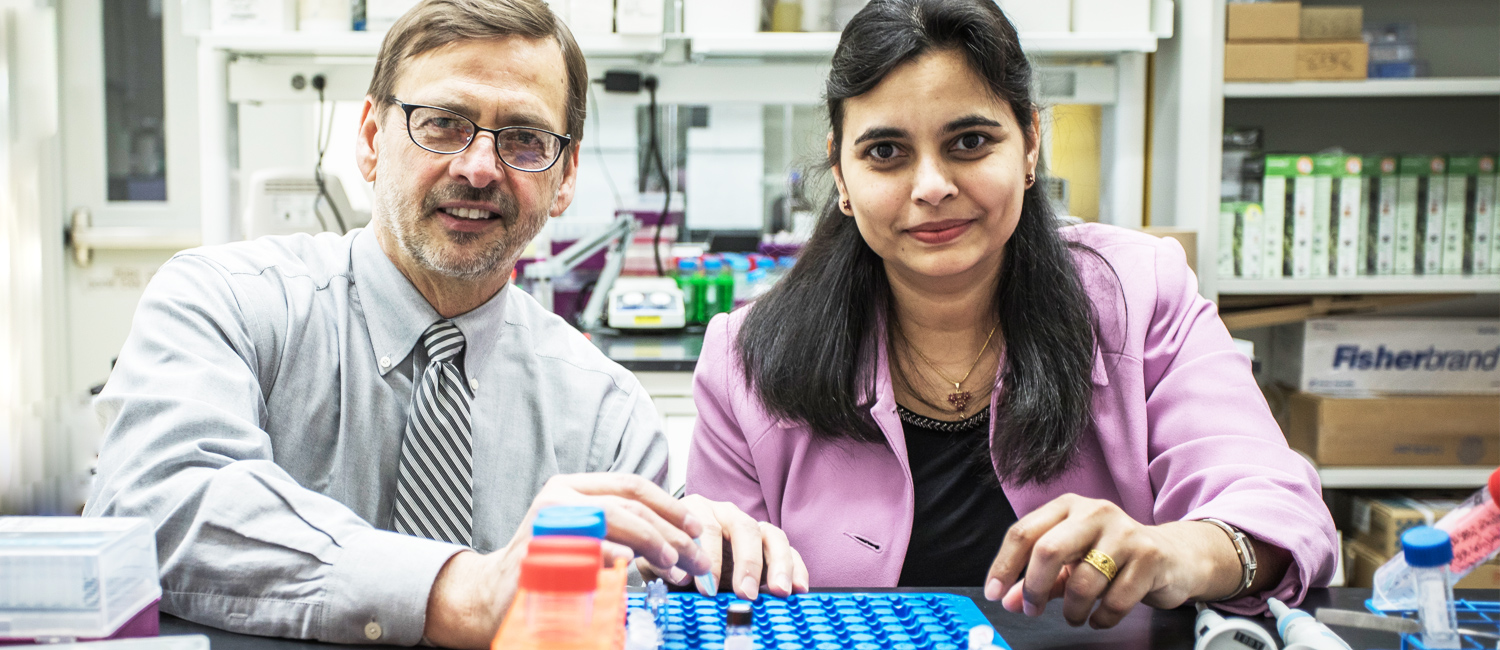 Douglas Stafford and Shama Mirza in a lab at the Milwaukee Institute for Drug Discovery.