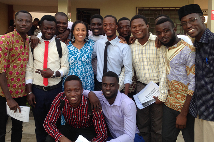 Elizabeth Drame poses with educators in Senegal.