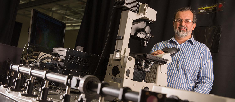 Valerica Raicu with his multiphoton microscope.