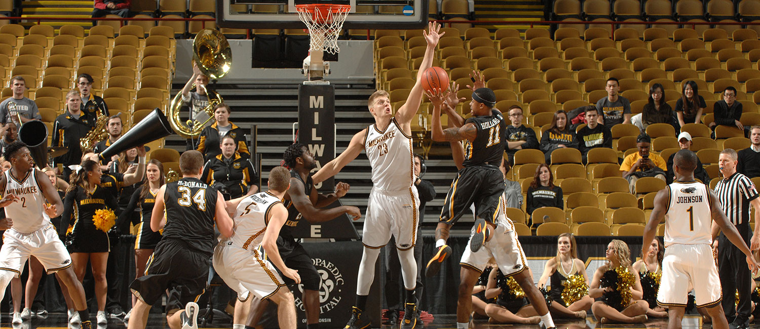 JJ Panoske blocks a shot while playing basketball for UWM.