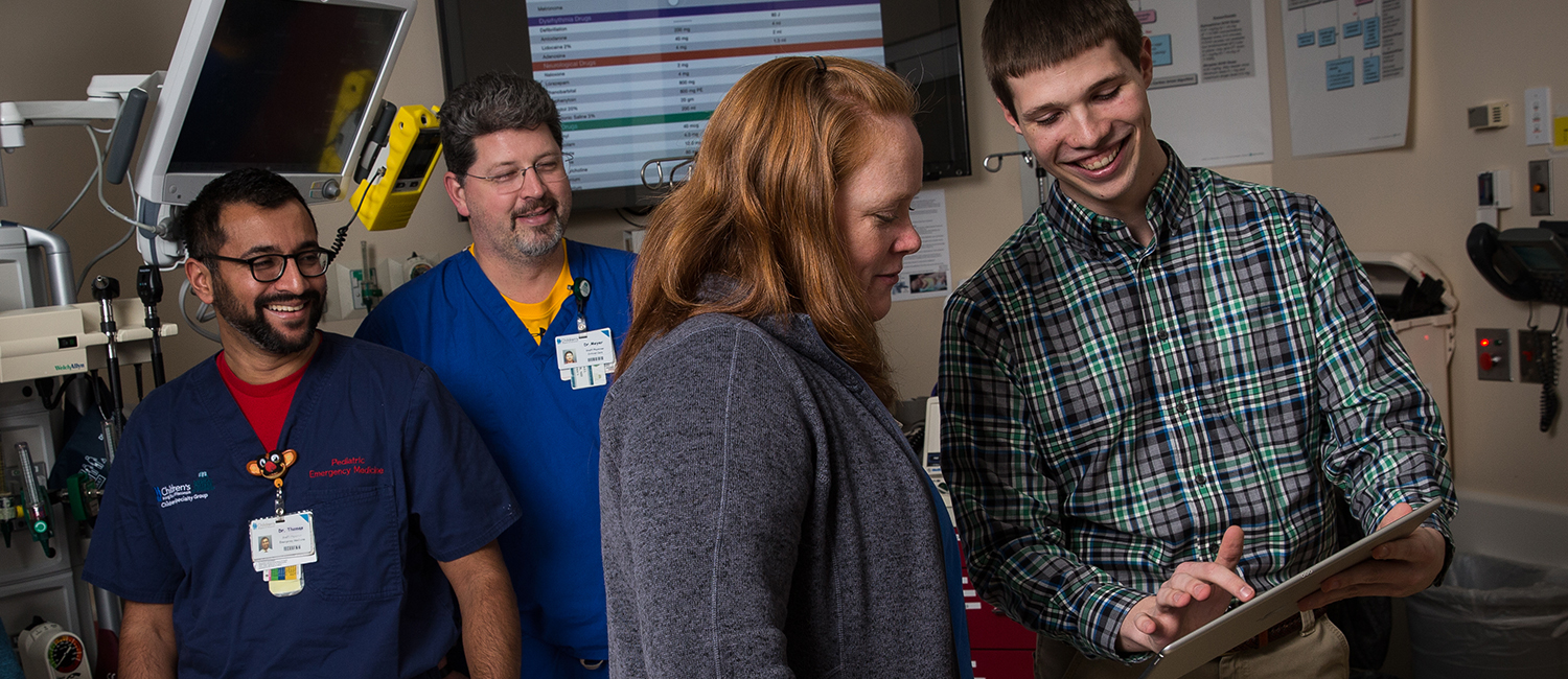 UWM student Evan Timmermann demonstrates a pediatric emergency app for doctors at Children's Hospital of Wisconsin.