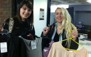 Cassandra Rasch (left), junior in communication sciences and disorders, and Makensie Gustafson, senior in conservation and environmental science, show off a couple of finds in the Career Closet. (UWM Photo/Kathleen Quirk)