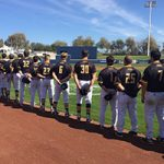 The UWM Panthers line up for the national anthem before taking on the Milwaukee Brewers at Maryvale Baseball Park in Phoenix on Friday. (UWM Photo)