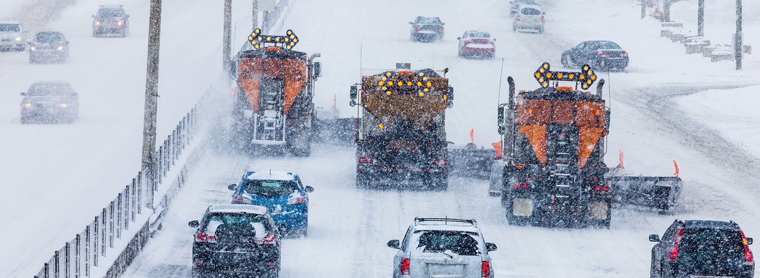 Traffic crawls through snow