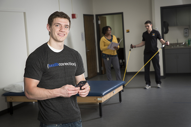 Jordan Mather, a senior marketing student, built a mobile platform that allows health-care providers to communicate with their patients through HIPAA-compliant instructional videos, messaging and visual progress tools. The app also allows patients to store shared information to review later. That could, for example, prevent physical therapy patients from losing their exercise instructions. (UWM Photo/Troye Fox)