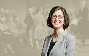 A photo of Mary Sarah Bilder is superimposed over a painting of the creation of the U.S. Constitution.