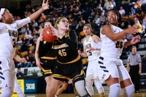 Lizzie Odegard battles against UNC-Greensboro in the WBI semifinals Thursday night. UWM lost 59-49. (Photo by Carlos Moralas)