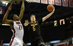 UWM's Cody Wichmann goes up for a basket.