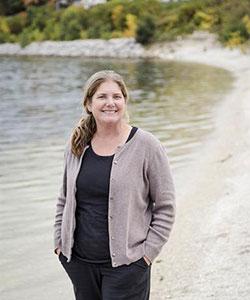 Sandra McLellan standing by water