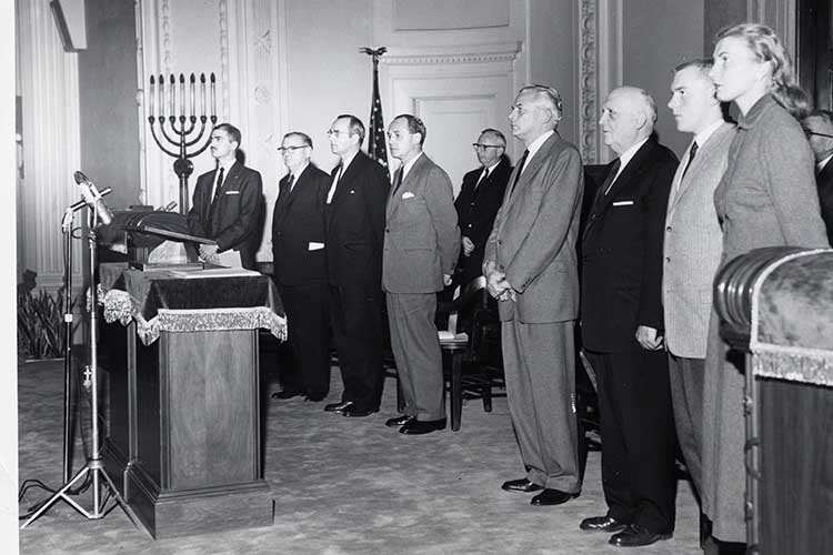 Dignitaries at the opening ceremony for the new UWM in October 1956 at Temple Emanu-El B'ne Jeshurun include (from left) Albert Davis, aide to Milwaukee Mayor Frank Zeidler; William D. McIntyre, president of the Board of Regents of State Colleges; Charles D. Gelatt, president of the University Board of Regents; Wisconsin Gov. Walter J. Kohler; provost J. Martin Klotsche; Edwin B. Fred, president of the University of Wisconsin; Donald Rambadt, UWM student government president; and Helen Rehlsein, student senate president. (UWM archives)