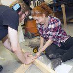 Sophomores Ben Lisowski and Aliyah Goldberger work together building the set. (UWM Photo/Pete Amland)