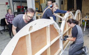 "Aliyah Goldberger (from left), Christopher Guse, Denis Kavanaugh, Ben Lisowski and Peter de Guzman work on the ""Arcadia"" set at Shorewood High School. (UWM Photo/Pete Amland)"