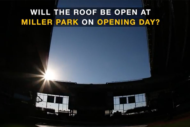 "The sun peaks through the opening roof at Miller Park. Text over the photo reads ""Will the roof be open at Miller Park on Opening Day?"""