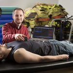 UWM grad student David Cornell performs a test on a patient.