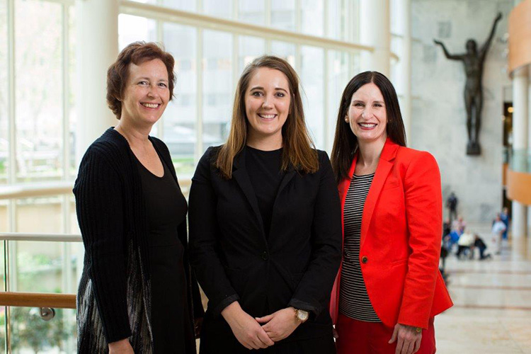 Stephanie Denzer, Holli Johnson and Kelli Passalacqua pose at the Mayo Clinic in Rochester, Minnesota.