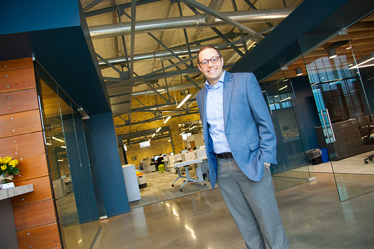 Mike Hacker stands at his firm's corporate offices at Bray Architects.