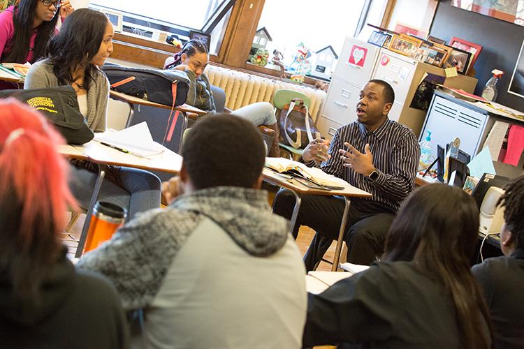 Students watch the teacher talk.