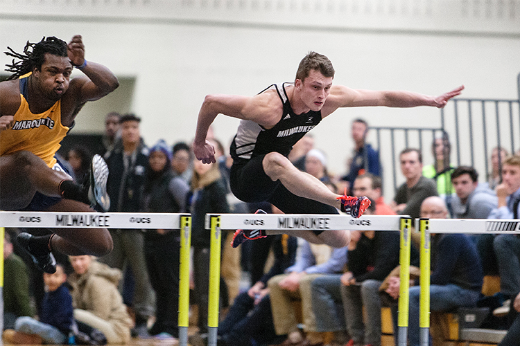 Taylor Koss races over a hurdle.