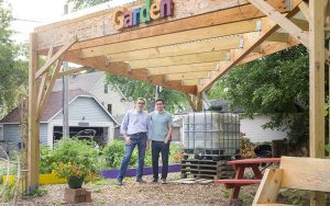 Miceli and his son stand under the rain gazebo they designed.