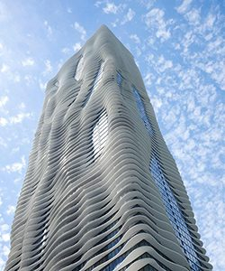 The photo of the tower from below shows its undulating waves of balconies.
