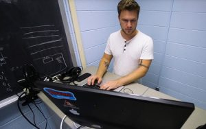 A student works on a computer.