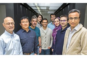 Scientists stand in a hallway.