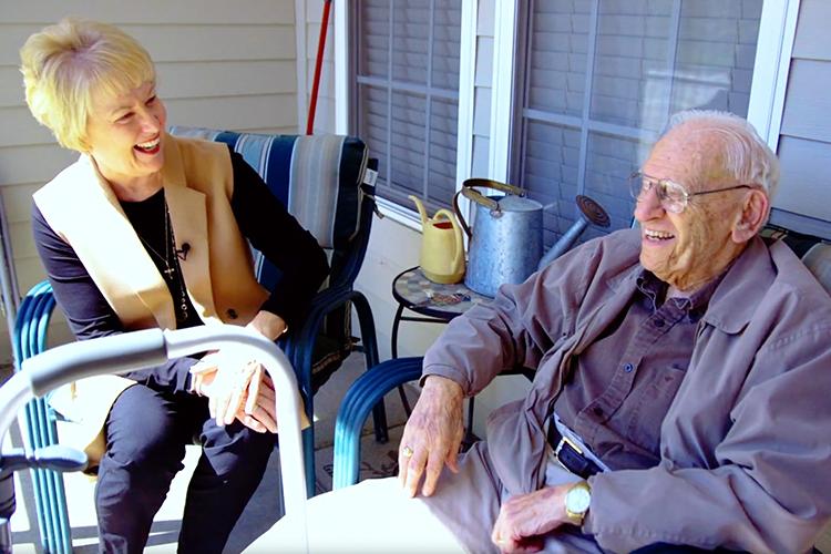 Marilyn Rantz laughs with an elderly man.