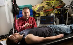 Graduate student David Cornell measuring a person's heart rate