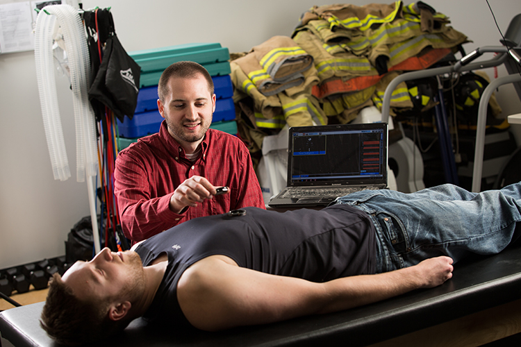 Graduate student David Cornell measuring a person's heart rate