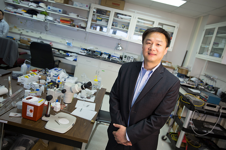 Junghon Chen stands in his lab.