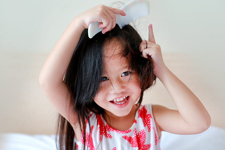 Child coming her hair