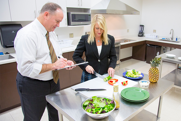 Ron Cisler and Jennifer Fink preparing a salad