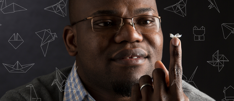 Adebola Oyefusi holding a small piece of foldable plastic