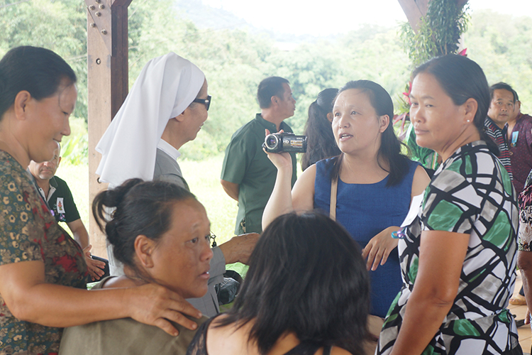 Vang interviews members of the Hmong community in Cacao, French Guiana.