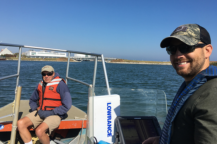 John Janssen and Brennan Dow on a boat in the Milwaukee harbor