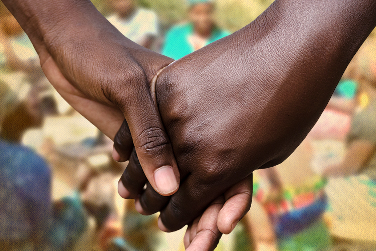 Close up of two hands holding