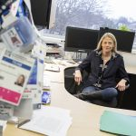 Barbara Meyer sits behind her desk in her office.
